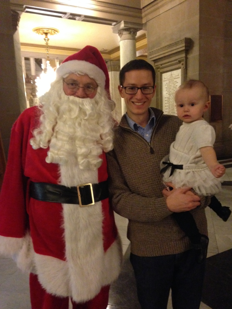 Charlotte very warily greeted Santa Claus.