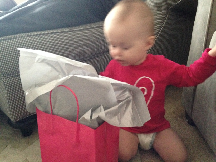 Blurry is not blog-worthy, but this is all I have when it comes to opening her present.