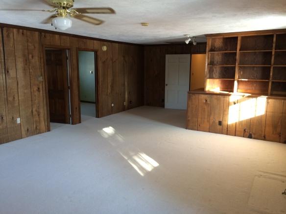 "BEFORE: The ""beautiful"" wood-paneled Bum Room."