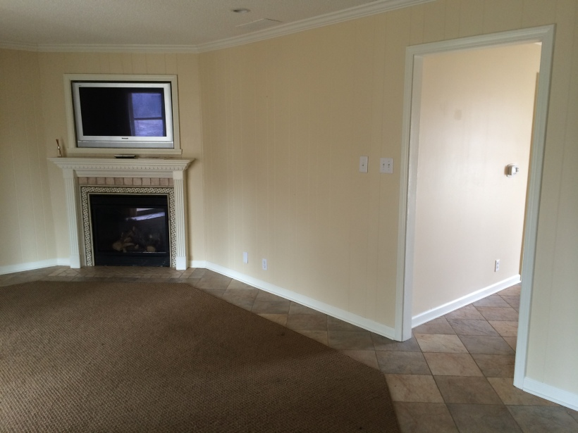 BEFORE: The informal living room with a wall bordering the formal living room.