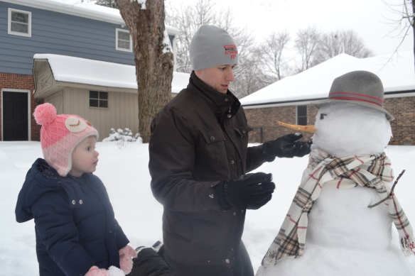 Ryan takes his snowman building very seriously.