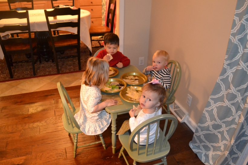 Small children eating together at a table is the most adorable thing ever.