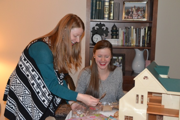 The Aunties setting up her dollhouse.